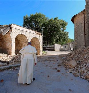 Pope Francis walks among debris and damaged buildings after the central-Italy earthquake