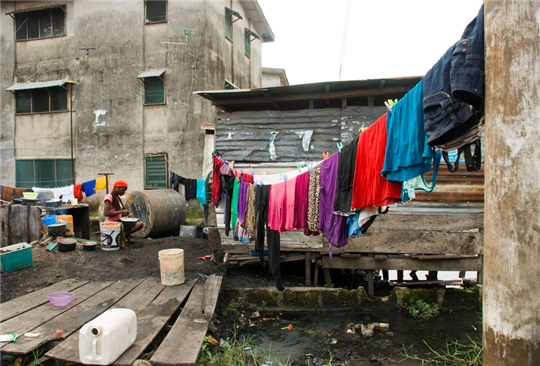 Woman with laundry on clothesline