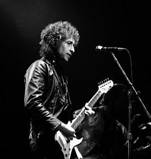 Bob Dylan at Massey Hall, Toronto, 1980 Photo by Jean-Luc Ourlin via Wikimedia Commons