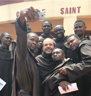 Fr. Federico Trinchero, Carmelite missionary, with his young brothers in front of Saint Marc Major Seminary in Bangui.