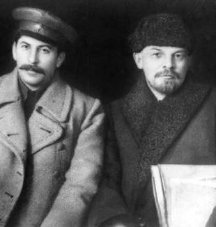 Joseph Stalin (left) and Vladimir Lenin. Part of larger photo of VIII Congress of the Russian Communist Party. Via Wikimedia Commons