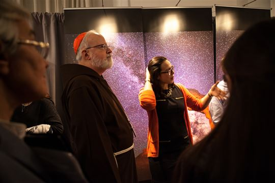 Cardinal Sean O'Malley visits the Millennial exhibit. Photo by Emily Marsolek
