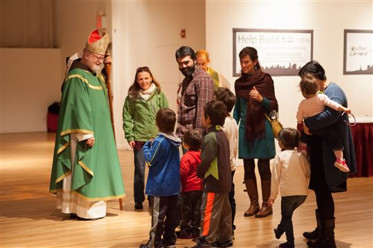 Cardinal O'Malley greets a family at New York Encounter. Photo by Emily Marsolek