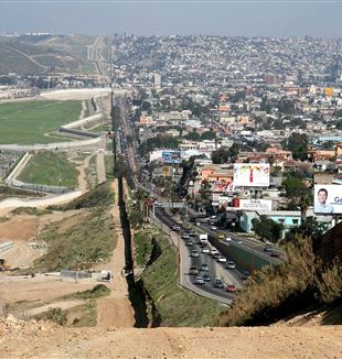 Fence separating Mexico from the United States. Photo by Sgt. Gordon Hyde via Wikimedia Commons