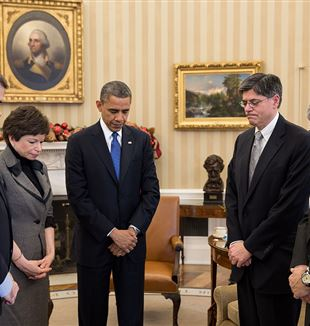 The President and others observe a moment of silence in the Oval Office, following the Sandy Hook shooting. Photo by Pete Souza via Wikimedia Commons