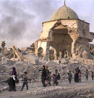 Civilians Walking Amidst Rubble in Mosul. Wikimedia Commons
