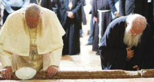 Pope Francis prays at the Holy Sepulcher with Bartholomew I.