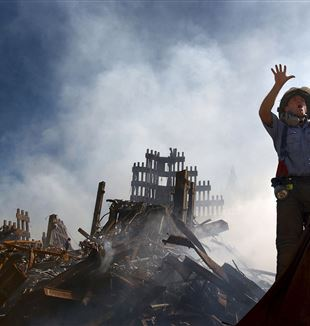 Fireman among the rubble from the Twin Towers. Wikimedia Commons