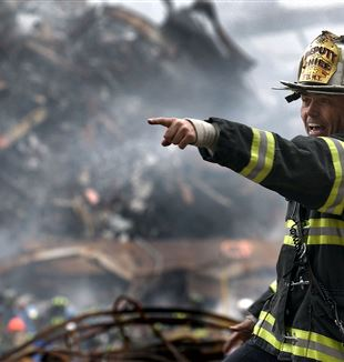 New York Fire Fighter among the rubble at WTC. Wikimedia Commons
