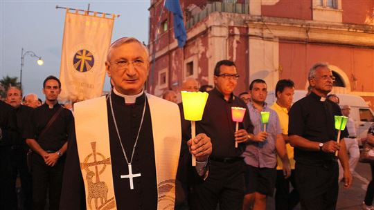 Monsignor Filippo Santoro during a vigil for the ILVA workers in Taranto