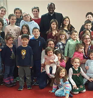 The children in Boston with Fr. Marcel